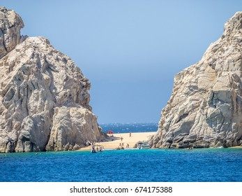 Two-sided lovers' beach between dramatic rock formation in Cabo San Lucas at he extreme southern end of Mexico's Baja California Peninsula, linking the Pacific Ocean and the Sea of Cortez,