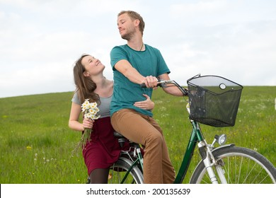 twosome on bicycle