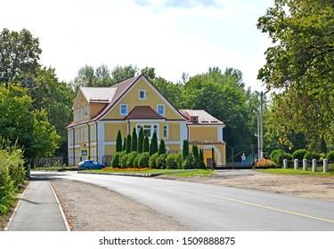 Two-storey building with mezzanine on Soviet Street. Village of Dobrovoksk, Kaliningrad region