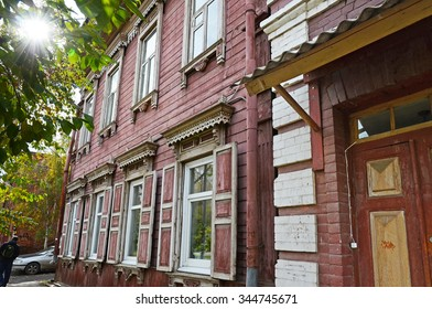 Two-storied wooden house with porch and window shutters on Irkutsk street. Russia