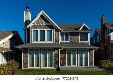 Two-story beach house with gray weathered shingle siding
