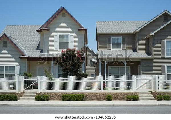 Two-story craftsman style low income single family residential development in a dense urban area
