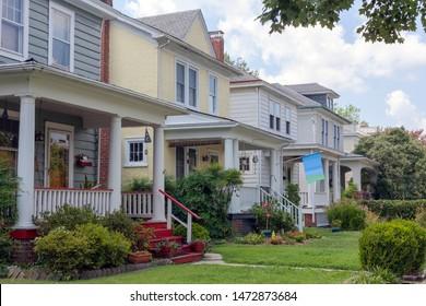 Two-story homes on residential neighborhood block.