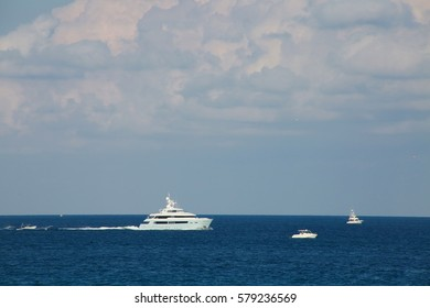 Two-Story Luxury Yacht and Boats Moving in the Atlantic Ocean in a Bright Sunny Afternoon in February