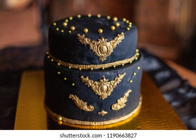 Two-tier blue-gold royal cake with large beads