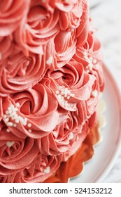 two-tier cake with cream roses