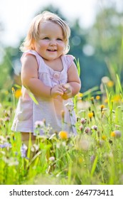 Two-years child at meadow in summer