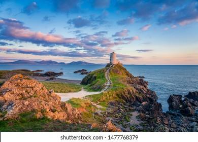 Ty Mawr Lighthouse at sunset on Llanddwyn Island in North Wales