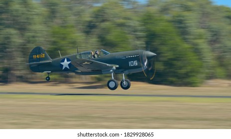 Tyabb, Victoria / Australia - March 9 2014: Curtiss P-40F Warhawk taking off at Tyabb Airport as a demonstration in the 2014 airshow