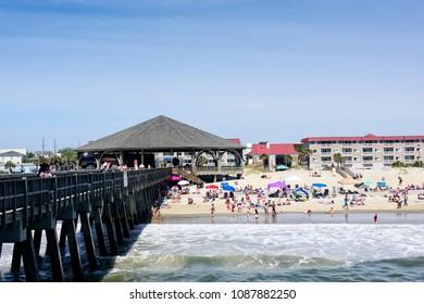 Tybee Island, Georgai - May 5, 2018:  People enjoying a day at the beach on the Atlantic Ocean in Tybee Island, Georgia