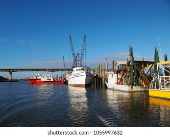 TYBEE ISLAND, GEORGIA - FEBRUARY 23, 2018: An assortment of fishing and other boats are docked on a sunny day at Lazaretto Creek Marina, near Savannah, Georgia.