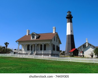 Tybee Island lighthouse with green grass and blue sky