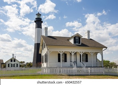 Tybee Island Lighthouse, a historic lighthouse with colonial era ties near Savannah, Georgia.  Classic lighthouse image with fluffy clouds and sunny skies.