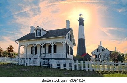 Tybee Island lighthouse late afternoon with sun behind the lighthouse