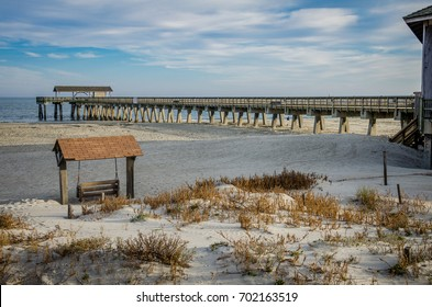 Tybee Island pier in Southern Georgia United States on the beach of the Atlantic Ocean, and a swing