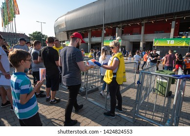 TYCHY, POLAND - JUNE 7, 2019: City Stadium Tychy before match U-20 World Cup Poland 2019 1/4 finals Match Italy vs Mali. Stewards chcckins tickets at the entrance to the stadium
