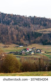 Tylmanowa village with neighbours houses in valley, Beskid Sadecki in Poland view from hill