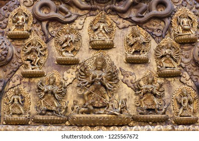 Tympanum - architecture detail with ancient bas-relief at Royal Palace on Durbar Square in Patan, Kathmandu Valley, Nepal
