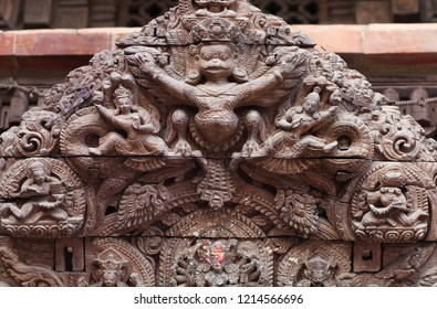 Tympanum with Garuda hindu god - architecture detail with ancient wooden bas-relief at Palace on Durbar Square in Patan, Kathmandu Valley, Nepal
