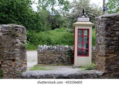 TYNEHAM, DORSET, ENGLAND, MAY 31 2016: Vintage English telephone box in the abandoned village of Tyneham in Dorset