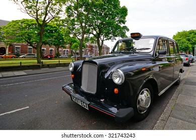 TYNEMOUTH - 15 JUNE : Taxi at 15 June 2015 in Tynemouth, England. Taxis in England are mainly old-fashioned cars.