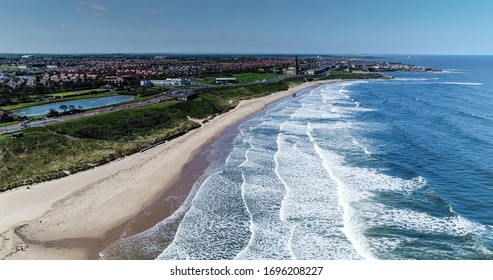 Tynemouth Longsands Beach Aerial Image with the boating lake to the left and the iconic St Georges church to the centre. Beautiful aerial seascape landscape