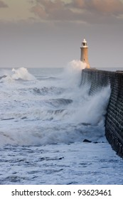 Tynemouth north pier with waves / Waves crashing against Tynemouths pier and lighthouse