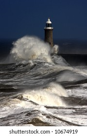 Tynemouth Pier and rough winter stormy weather with breaking waves