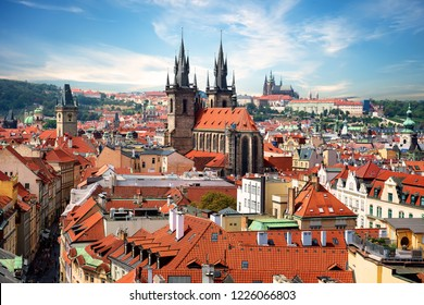 Tynsky and St Vitus cathedral among the red roofs of Prague. View from above