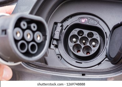 Type 2 plug on the charging socket of a hybrid car