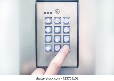 Type a code on a  electronic combination lock, bright white