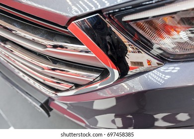 type headlights of the vehicle, note shallow depth of field