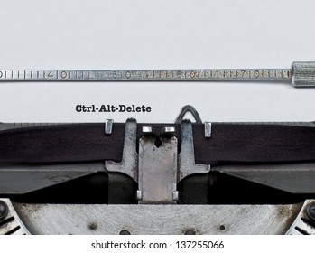 """Type on an antique typewriter that reads, """"Ctrl-Alt-Delete"""". A parody on computer commands and legacy IT systems with the text incongruous on a typewriter and implying that systems should be updated."""