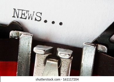 type spelling the word news on a vintage typewriter, great concept for blogs, journalism, news, newsletters, press releases, authors and the mass media