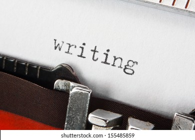 type spelling the word writing on a vintage typewriter, great concept for blogs, journalism, news, authors or the mass media