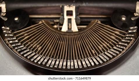 typebars of an obsolete typewriter