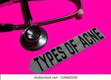 Types of acne on the paper with healthcare concept. With stethoscope on pink bakcground