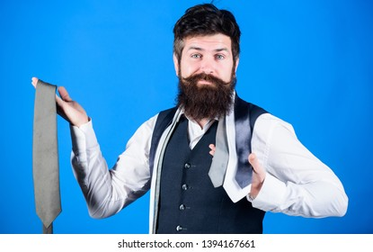 Types of necktie accessories. By presenting polished look for work or social occasions, neckties enhance wardrobe. Man bearded hipster hold few neckties. Guy with beard choosing tie. Perfect necktie.
