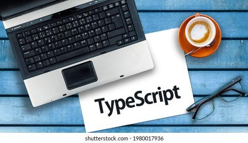 TypeScript Programming Language. Word TypeScript on paper and laptop