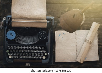Typewriter and blank open book on a writer author table background.