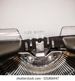 Typewriter closeup shot, concept of join us