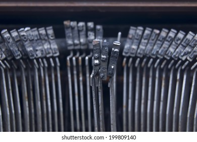 Typewriter an electric, electronic, or manual machine with keys for producing print like characters one at a time on paper inserted around a roller.