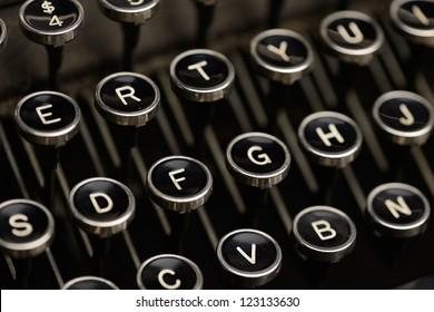 Typewriter keys. Angled shot of keys on an antique typewriter. Shallow DOF.