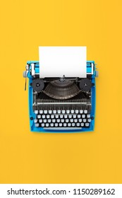 Typewriter machine in retro style on yellow background. Top view.