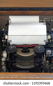 Typewriter machine with white paper in roll