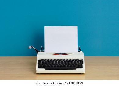 Typewriter on a desk with blue background