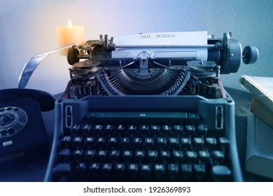 typewriter on table, words fake news are printed on paper in large size, candle is burning, retro style, concept of information hoax in social media, misleading, exposing deception, old school