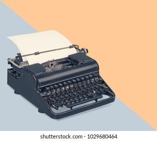 Typewriter over a pastel background