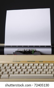 Typewriter with a piece of paper inserted.