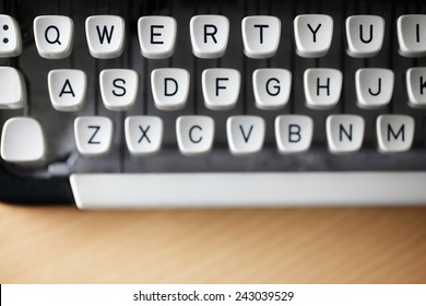 Typewriter qwerty keys on wooden desk